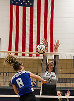 Prospect Mountain's Catie Leberman goes up to block a shot by Interlakes Jordan Durand during NHIAA Division III volleyball on Monday evening.  (Karen Bobotas/for the Laconia Daily Sun)