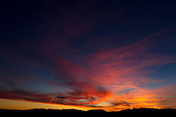 dramatic sunset in Santa Fe, New Mexico over the mountains