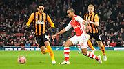 Theo Walcott playing a through ball during the The FA Cup match between Arsenal and Hull City at the Emirates Stadium, London, England on 4 January 2015. Photo by Michael Hulf.