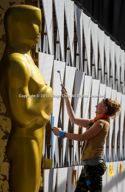 A work paints the scenic walls in the red carpet arrivals area in front of the Dolby Theatre on Thursday Feb. 25, 2016 in Los Angeles. The 88th Academy Awards will be held Sunday, February 28, 2016. (Photo by Ringo Chiu/PHOTOFORMULA.com)<br /> <br /> Usage Notes: This content is intended for editorial use only. For other uses, additional clearances may be required.