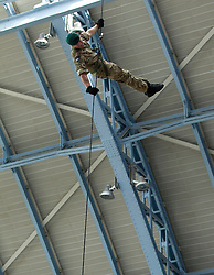 © Licensed to London News Pictures. 14/09/2012. LONDON, UK. A Royal Marine Commando abseils from the roof of St Pancras International in London today (14/09/12). The abseil saw 15 abseilers descend from the roof of the station in an attempt to raise more than £150,000 for the Commando Spirit Appeal on behalf of the Royal Marines Charitable Trust. Photo credit: Matt Cetti-Roberts/LNP