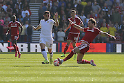 Middlesbrough defender George Friend tackles Leeds United midfielder Lewis Cook   during the Sky Bet Championship match between Middlesbrough and Leeds United at the Riverside Stadium, Middlesbrough, England on 27 September 2015. Photo by Simon Davies.