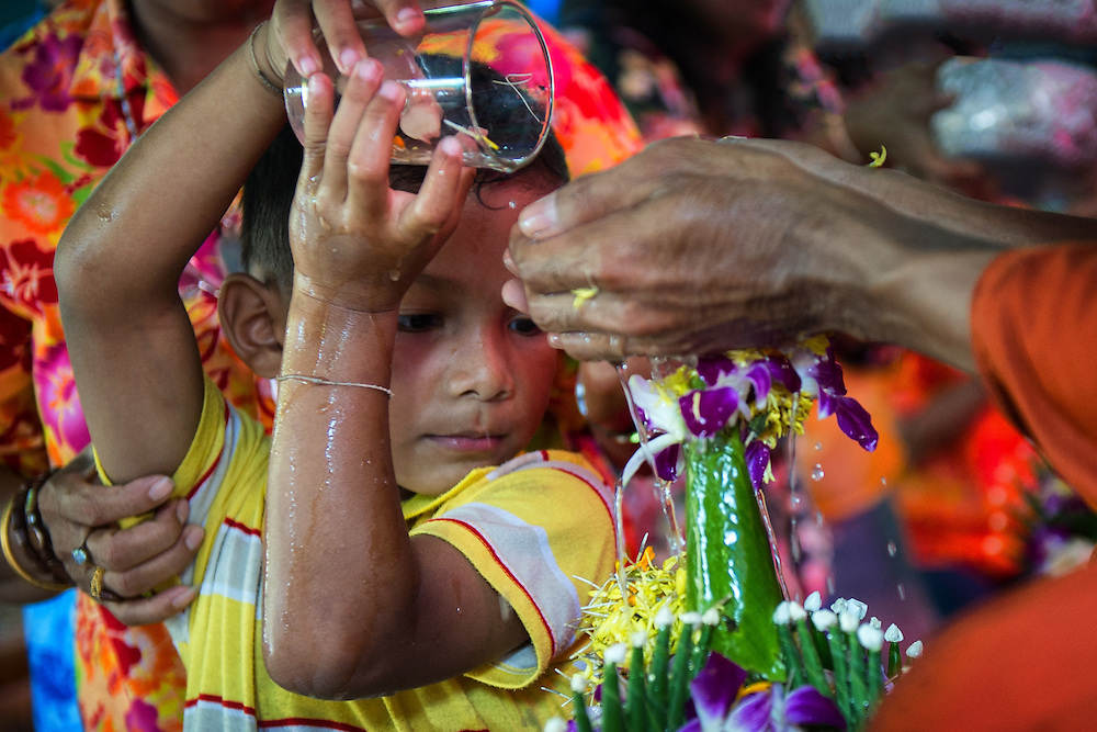 Pouring water for merit at Songkran in Nakhon Nayok, Thailand