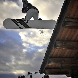 Pedro Patri?cio, rider and Photographer going aerial over a chalet in the Val Gardena ski domain.