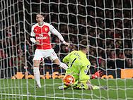 Arsenal's Mesut Ozil scoring his sides second goal<br /> <br /> Barclays Premier League- Arsenal vs AFC Bournemouth - Emirates Stadium - England - 28th December 2015 - Picture - David Klein/Sportimage