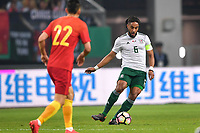 Ashley Williams, right, of Wales national football team kicks the ball to make a pass against Yu Dabao of Chinese national men's football team in the semi-final match during the 2018 Gree China Cup International Football Championship in Nanning city, south China's Guangxi Zhuang Autonomous Region, 22 March 2018.
