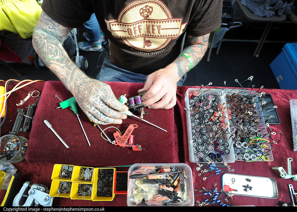 © Licensed to London News Pictures. 23/09/2011. LONDON, UK. A blacksmith makes tattoo machines. The 7th London Tattoo convention takes place today (23 Sept 2011) at the Tobacco Dock in the East End of London. The convention attracts artists and customers from all over the world. It runs until 25th September 2011. Photo credit:  Stephen Simpson/LNP