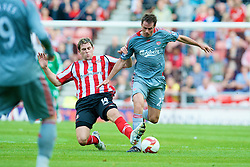 SUNDERLAND, ENGLAND - Saturday, August 16, 2008: Liverpool's Jamie Carragher and Sunderland's Daryl Murphy during the opening Premiership match of the season at the Stadium of Light. (Photo by David Rawcliffe/Propaganda)