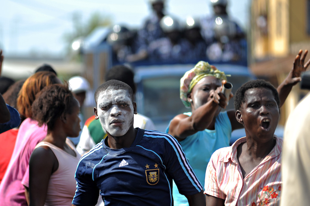 LOME, TOGO - 12-10-05   - Opposition protesters shout at Gendarmes during clashes in the Lomé neighbourhood of Bé. Protesters clashed with police in Lomé on October 5. A peaceful protest was scheduled by opposition groups, but their route was blocked by police.  For months, opposition parties have been calling for the departure of president Faure Gnassingbe, whose family has been in power for over 40 years.   Photo by Daniel Hayduk