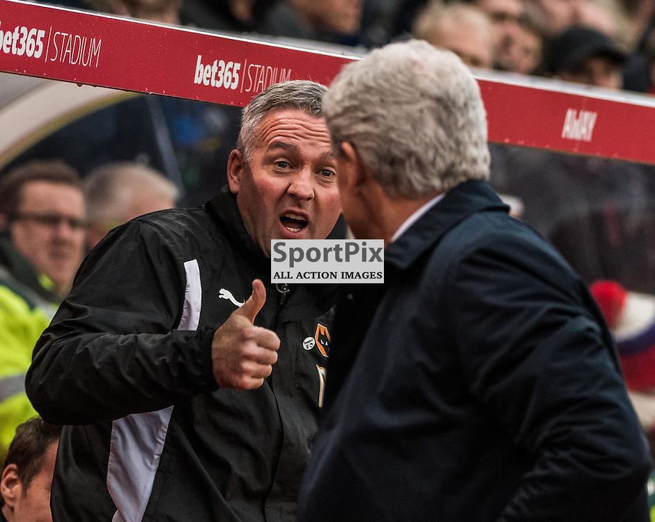 Wolverhampton Wanderers manager Paul Lambert greets Stoke City manager Mark Hughes before the FA Cup 3rd round match between Stoke City and Wolverhampton Wanderers<br /> <br /> (c) John Baguley | SportPix.org.uk