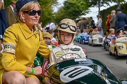 © Licensed to London News Pictures.09/09/2018. Goodwood. West Sussex, UK. <br /> The Goodwood motor circuit celebrates the 20th anniversary of the Revival.The Revival has become one of the biggest annual historic motorsport events in the world and the only one to be staged entirely in period dress. Each year over 150,000 people descend on this quiet corner of West Sussex to enjoy the three-day event. <br /> Pictured A young female driver and mechanic Mum.<br /> Photo credit: Ian Whittaker/LNP