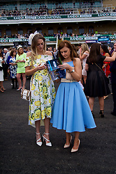 LIVERPOOL, ENGLAND - Thursday, April 6, 2017: Racegoers study the form card, during The Opening Day on Day One of the Aintree Grand National Festival 2017 at Aintree Racecourse. (Pic by David Rawcliffe/Propaganda)