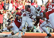 Nov 15, 2014; Tuscaloosa, AL, USA; Alabama Crimson Tide linebacker Trey DePriest (33) and Dalvin Tomlinson (54) tackle Mississippi State Bulldogs quarterback Dak Prescott (15) for a safety in the first quarter at Bryant-Denny Stadium. Mandatory Credit: Marvin Gentry