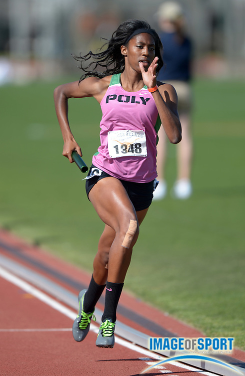 Mar 29, 2014; Austin, TX, USA; Ebony Crear runs the second leg on the Long Beach Poly girls 4 x 400m relay that placed second in the Division II girls race in 3:42.84 in the 87th Clyde Littlefield Texas Relays at Mike A. Myers Stadium.
