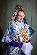 Lena, member of the 'De &Ouml;wepetters e.V.' is wearing an original traditional bridal costume of the Wendland Region in K&uuml;sten, Lower Saxony, Germany on December 27, 2016.<br /> <br /> The dress is an original from around 1860. It is an heirloom from &Ouml;wepetter's director, Undine, who inherited it from her great grandmother and grandmother. Besides her mother, all women of her family have married in this dress.<br /> Only pristine women were allowed to wear the bridal crown.<br /> <br /> This is part of the series about Traditional Wedding Gowns from different regions of Germany, worn by young members of local dance groups and cultural associations that exist to preserve and celebrate the cultural heritage. The portraiture series is a depiction of an old era with different social values and religious beliefs in an antiquated civil society with very few of those dresses left.