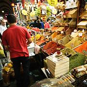Customers buying spices next to the Spice Bazaar (also known as the Egyption Bazaar) in Istanbul, Turkey.