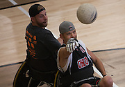 Danny White passes the ball during the 8th Annual FourPlay! Quad Rugby Tournament in the Ping Recreation Center on Oct. 4, 2014. Photo by Lauren Pond