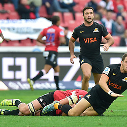 Johannesburg, SOUTH AFRICA, 21, MAY 2016 - during the Super Rugby match between Emirates Lions vs Jaguares ,Emirates Airlines Park,Johannesburg.<br /> Franco Mostert of the Emirates Lions tackles Joaquín Tuculet of the Jaguares. <br /> <br /> South Africa. (Photographer Christiaan Kotze ) -- (Steve Haag Sports) <br /> <br /> Images for social media must have consent from Steve Haag