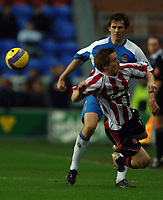 Photo: Paul Greenwood.<br />Wigan Athletic v Sheffield United. The Barclays Premiership. 16/12/2006. Sheffields Rob Kozluk, foreground, throws himself infront of Kevin Kilbane's pass