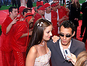Latin music star Marc Anthony (R) is interviewed with his wife Dayanara Torres (L) prior to the 2002 Latin Billboard Awards show taping in Miami Beach, Florida May 9, 2002. The event, which showcases the music industry's hotest latin music stars, will air on the Telemundo network, May 12, 2002. PHOTO BY: COLIN BRALEY