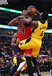 November 2, 2018 - Chicago, IL, USA - The Chicago Bulls' Wendell Carter Jr. (34) and the Indiana Pacers' Victor Oladipo (4) get tangled up in the first quarter at the United Center in Chicago on Friday, Nov., 2, 2018. The Pacers won, 107-105. (Credit Image: © John J. Kim/Chicago Tribune/TNS via ZUMA Wire)