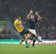 Australia's Kurtley Beale clearing the ball in a closely fought contest during the Rugby World Cup Quarter Final match between Australia and Scotland at Twickenham, Richmond, United Kingdom on 18 October 2015. Photo by Matthew Redman.
