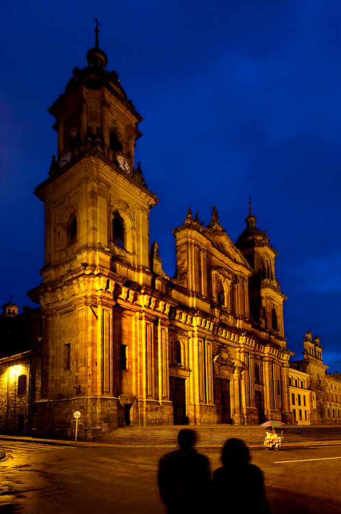 Colombia, Bogota, Catedral Primada, Metropolitan Cathedral Basilica of the Immaculate Conception, Plaza de Bolivar, Neoclassical Style, Bogota's Largest Church, Silhouetted Man and Woman Tourists, Dusk