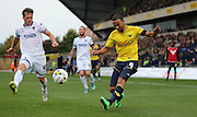 Oxford United midfielder Kemar Roofe (4) crosses during the Sky Bet League 2 match between Oxford United and AFC Wimbledon at the Kassam Stadium, Oxford, England on 10 October 2015.