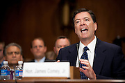 JAMES COMEY JR. testifies before the Senate Judiciary Committee on Capitol Hill on Tuesday during a hearing on his nomination to be director of the Federal Bureau of Investigation.