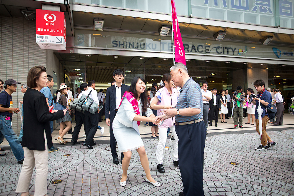 TOKYO, JAPAN - JULY 22 : Candidate Hiroko Nanami from Happiness Realization Party greets people a during a Tokyo Gubernatorial Election 2016 campaign rally at Shinjuku station, Tokyo, Japan on Friday, July 22, 2016. Tokyo residents will vote on July 31 for a new Governor of Tokyo who will deal with issues related to the hosting of the Tokyo Summer Olympics and Paralympics in 2020. (Photo: Richard Atrero de Guzman/NUR Photo)