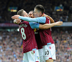 Aston Villa's Tom Cleverley celebrates with Aston Villa's Jack Grealish and Aston Villa's Kieran Richardson  - Photo mandatory by-line: Joe Meredith/JMP - Mobile: 07966 386802 - 09/05/2015 - SPORT - Football - Birmingham - Villa Park - Aston Villa v West Ham United - Barclays Premier League