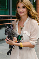 © Licensed to London News Pictures. 19/08/2012. London,UK.  Millie Mackintosh, of reality TV show Made in Chelsea, braves the rain and participates in exclusive fundraising walk The Sunday Strut, in aid of The Princes Trust.  Here with her dog Herbie Photo credit : Richard Isaac/LNP