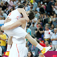 10 August 2012: Spain Marc Gasol celebrates the win with Jose Calderon following the 67-59 Team Spain victory over Team Russia, during the men's basketball semi-finals, at the North Greenwich Arena, in London, Great Britain.