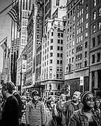 Pedestrians walking down 5th Avenue at corner of 53rd Street, New York City, NY, USA