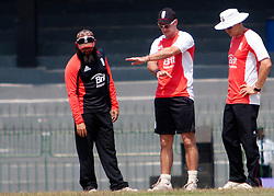 ©London News Pictures. 25/03/2011. England spin bowling coach Mushtaq Ahmed (L), captain Andrew Strauss (C) and coach Andy Flower (R) inspect the Colombo pitch . Photo credit should read Asanka Brendon Ratnayake/London News Pictures