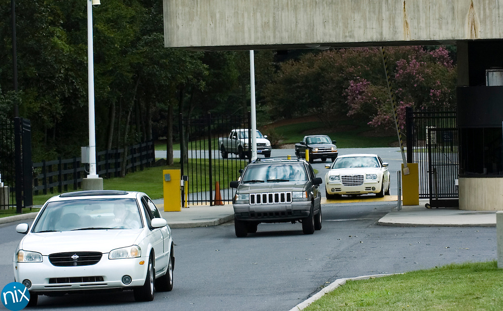 Cars pull out of the Philip Morris USA campus is Concord at the end of the day shift on the cigarette plants final day of production Wednesday, July 29.