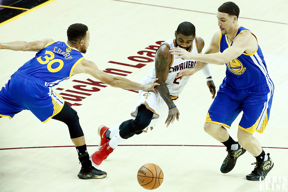 09 June 2017: Cleveland Cavaliers guard Kyrie Irving (2) drives past Golden State Warriors guard Stephen Curry (30) and Golden State Warriors guard Klay Thompson (11) during the Cleveland Cavaliers 137-11 victory over the Golden State Warriors, in game 4 of the 2017 NBA Finals, at  the Quicken Loans Arena, Cleveland, Ohio, USA.