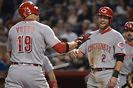 PHOENIX, AZ - JULY 08:  Joey Votto #19 of the Cincinnati Reds is greeted at home by Zack Cozart #2 after hitting a two run homer against the Arizona Diamondbacks during the first inning of the MLB game at Chase Field on July 8, 2017 in Phoenix, Arizona.  (Photo by Jennifer Stewart/Getty Images)