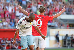 20.07.2013, Coface Arena, Mainz, GER, Testspiel, 1. FSV Mainz 05 vs West Ham United, im Bild Sebastian Polter (Mainz) feiert sein Tor...Winston Reid (West Ham United WHUFC) ist verzweifelt,,  // during the Friendly Match between 1. FSV Mainz 05 and West Ham United at the Coface Arena, Mainz, Germany on 2013/07/20. EXPA Pictures © 2013, PhotoCredit: EXPA/ Eibner/ Bildpressehaus<br /> <br /> ***** ATTENTION - OUT OF GER *****