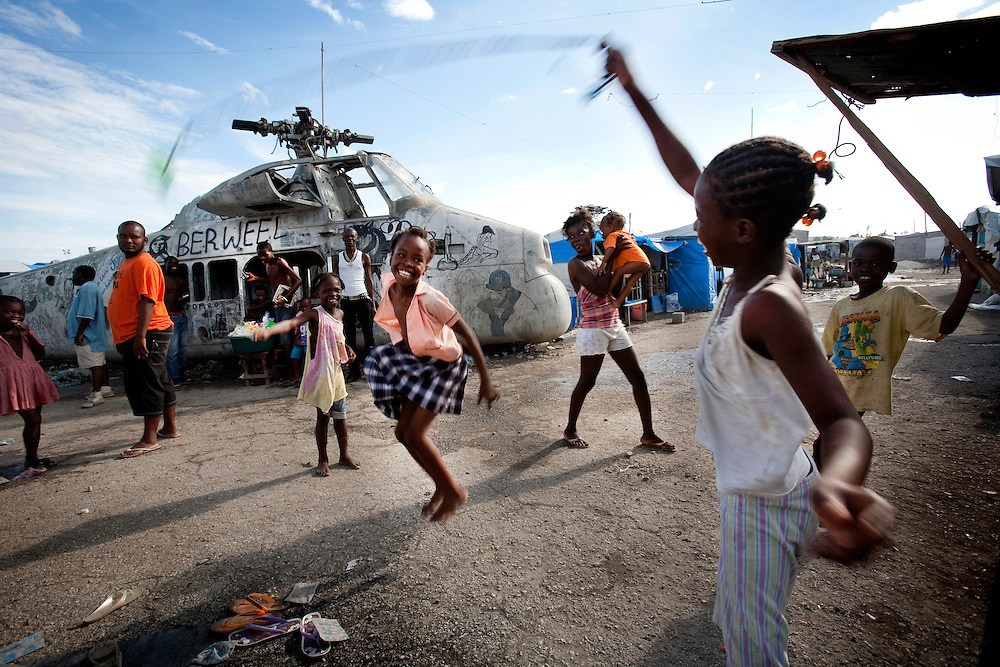 Girls playing jump rope in the makeshift refugee camp, La Piste, in Port-au-Prince, Haiti on July 15, 2010. La Piste (French for &quot;runway&quot;)is a settlement sprawled across the site of a disused airport and now home to an estimated 20,000 earthquake survivors living in makeshift structures.<br /> Six month after a catastrophic earthquake measuring 7.3 on the Richter scale hit Haiti on January 13, 2010, killing an estimated 230,000 people, injuring an estimated 300,000 and making homeless an estimated 1,000,000.