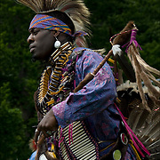 Aus Spotted Eagle ( Lipan Apache / Choctaw Nation Oklahoma and African American ), dressed in Cree Northern traditional regalia dancing in the &quot;Drums Along the Hudson&quot; Native American Festival, Inwood Hill Park, NYC.<br /> <br /> Release 2564