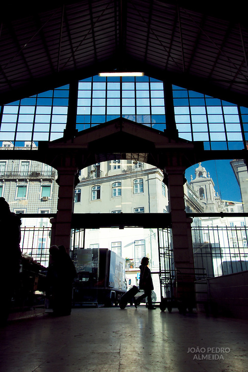 Ribeira's market glass wall at its back entrance.