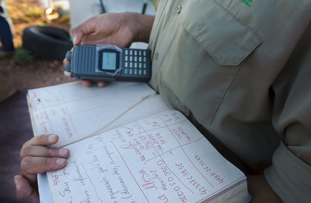 Alejandro Gonzales, field biologist, checks the GPS ID, data and signals prior to the release.