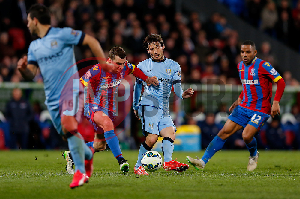 David Silva of Manchester City is challenged by James McArthur of Crystal Palace - Photo mandatory by-line: Rogan Thomson/JMP - 07966 386802 - 06/04/2015 - SPORT - FOOTBALL - London, England - Selhurst Park - Crystal Palace v Manchester City - Barclays Premier League.