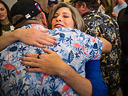 """15 JUNE 2019 - BOONE, IOWA: US Senator JONI ERNST (R-IA) hugs a supporter at """"Joni's Roast and Ride,"""" a motorcycle ride / fund raiser hosted by Ernst. Ernst, Iowa's junior US Senator, kicked off her re-election campaign during the """"Roast and Ride"""", an annual fund raiser and campaign event has she held since originally being elected to the US Senate in 2014.    PHOTO BY JACK KURTZ"""