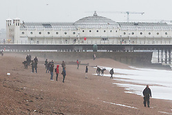 © Licensed to London News Pictures. 06/02/2016. Brighton, UK. Few people can be seen on Brighton beach as strong winds and powerful waves are battering Brighton seafront. Today February 6th 2016. Photo credit: Hugo Michiels/LNP