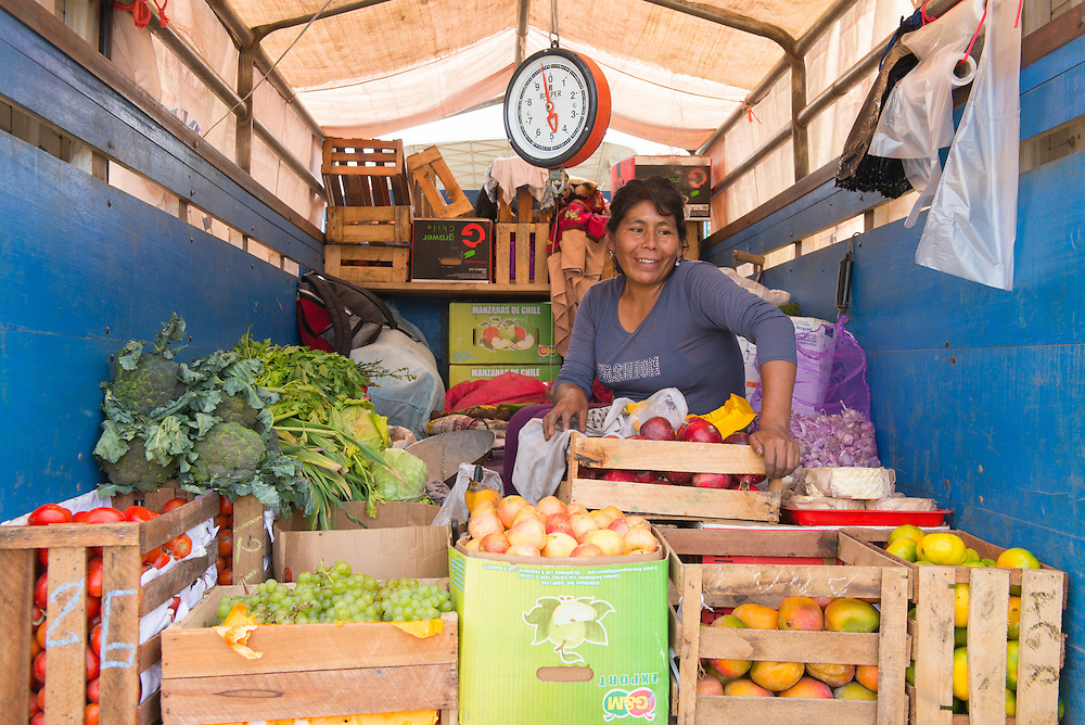 South America; Peru; Amazonia; Manu; woman selling vegetables out of truck