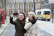 UNITED KINGDOM, London: 23 March 2017 Tourists take a 'selfie' in front of the cordon blocking off Westminster Bridge this afternoon after a terror attack which killed four people including the attacker in Westminster yesterday. Rick Findler / Story Picture Agency