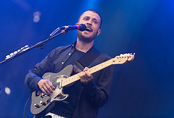 © Licensed to London News Pictures. 30/08/2015. Reading, UK. The Maccabees performing at Reading Festival 2015, Day 3 Sunday.  In this picture - Orlando Weeks.  Photo credit: Richard Isaac/LNP