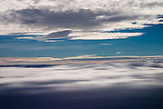 Shadow of clouds seen on a lower layer of clouds from a summit in the Greenland ice cap during a British mountaineering expedition to Knud Rasmussens Land, East Greenland, Arctic, 2006.